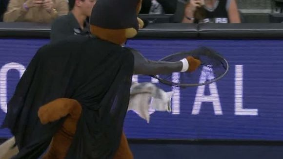 A Coyote Dressed as Batman Captures a Live Bat During NBA Game
