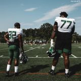 Large Human Football Player Mekhi Becton Photographed Next to Much Smaller Teammate