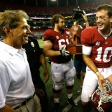 Nick Saban caught smiling in an unguarded moment