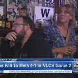 A stiff drink eases the agony of Cubs NLCS defeat.